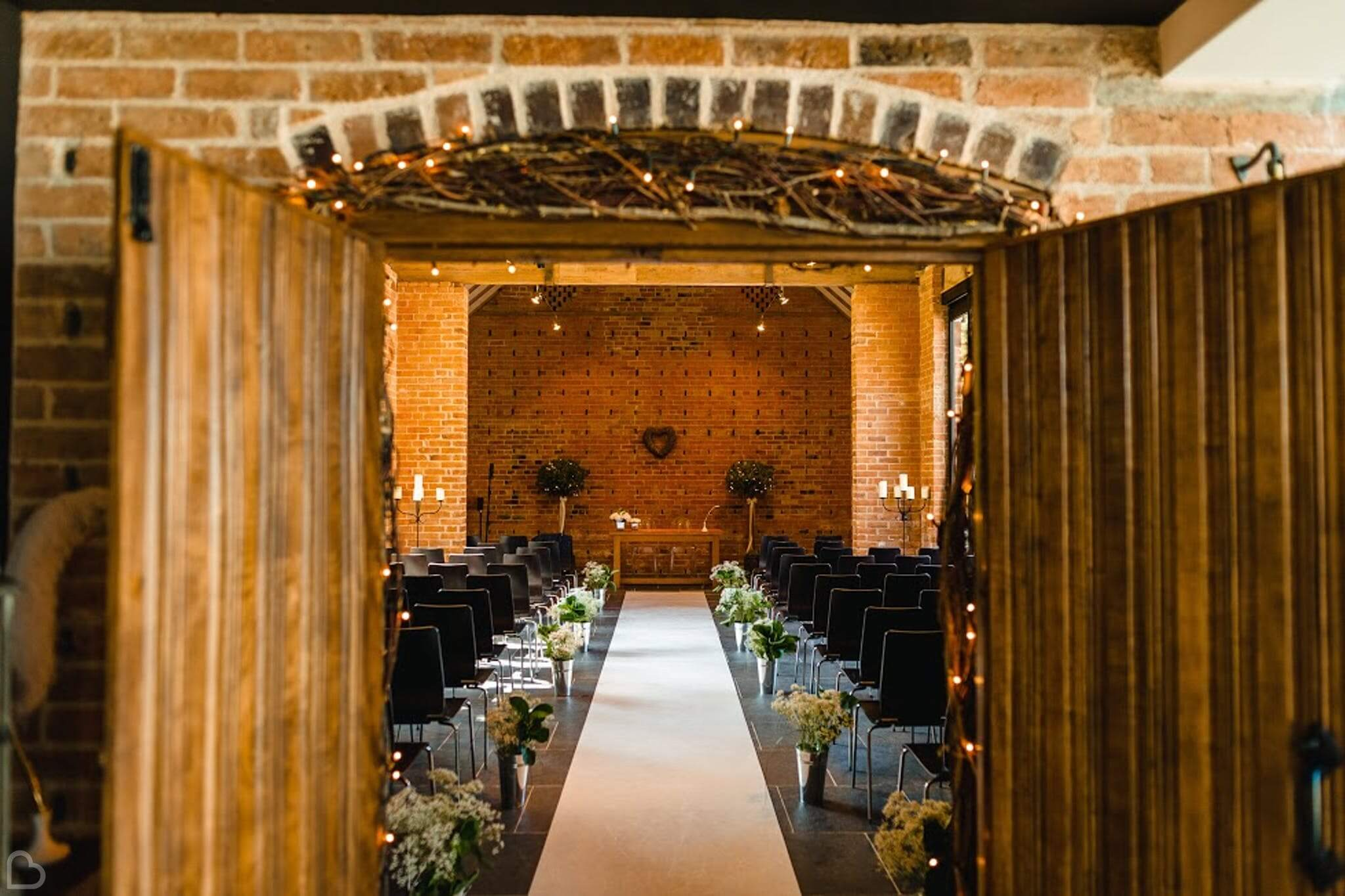 redhouse barn wedding venue set up for wedding ceremony