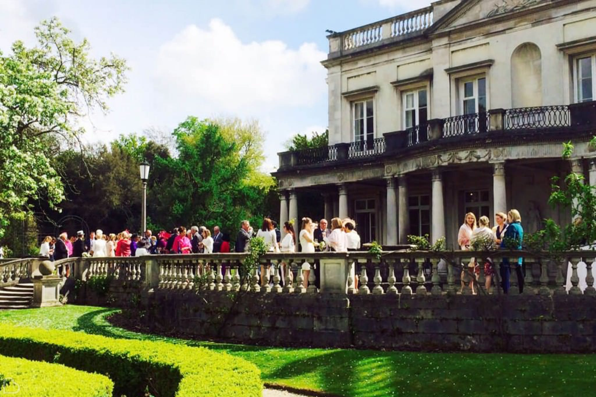 guests drink and eat on the balcony of grove house, one of the best wedding reception venues in London