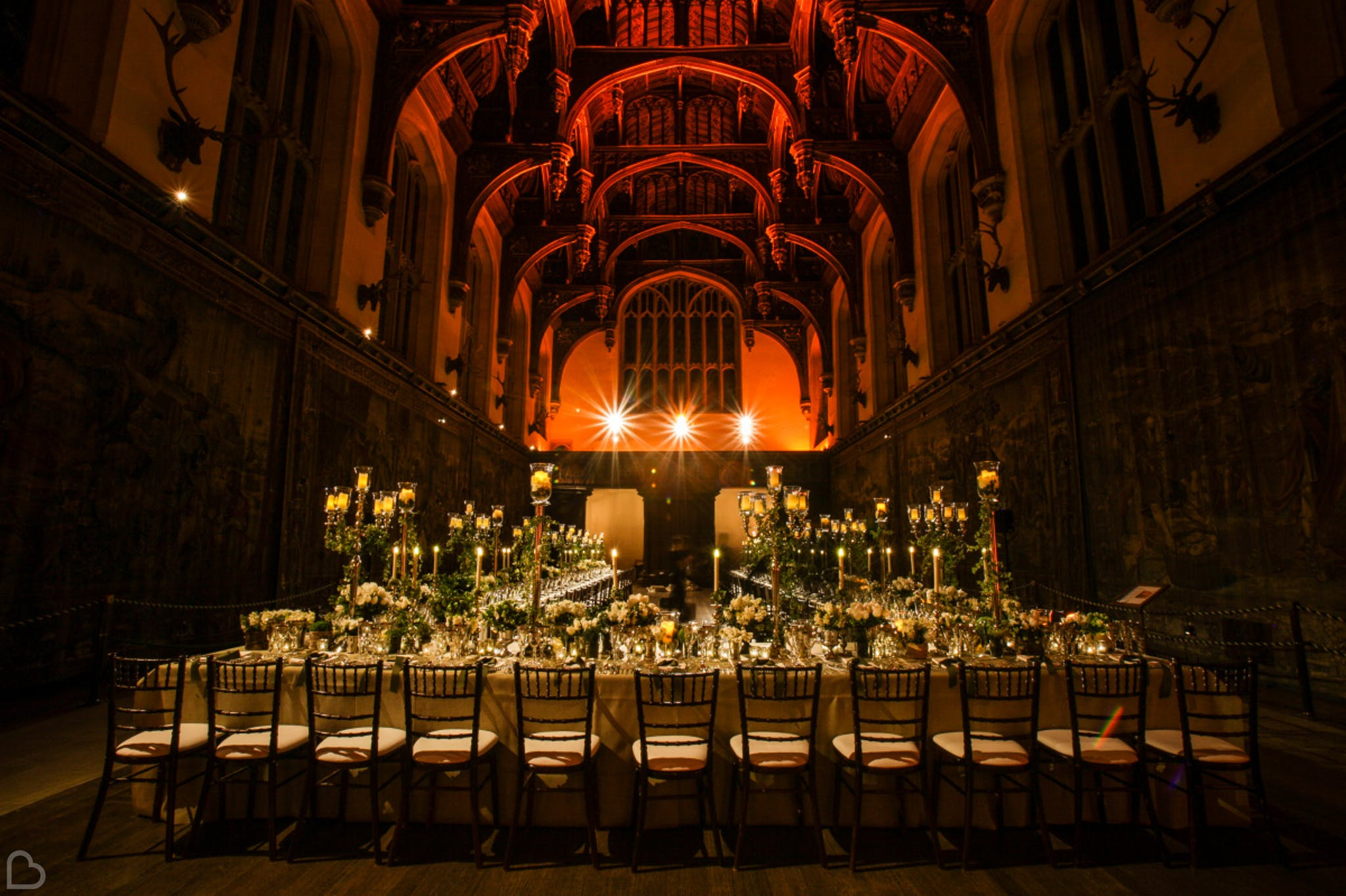the opulent  hampton court house, darkly lit for a wedding