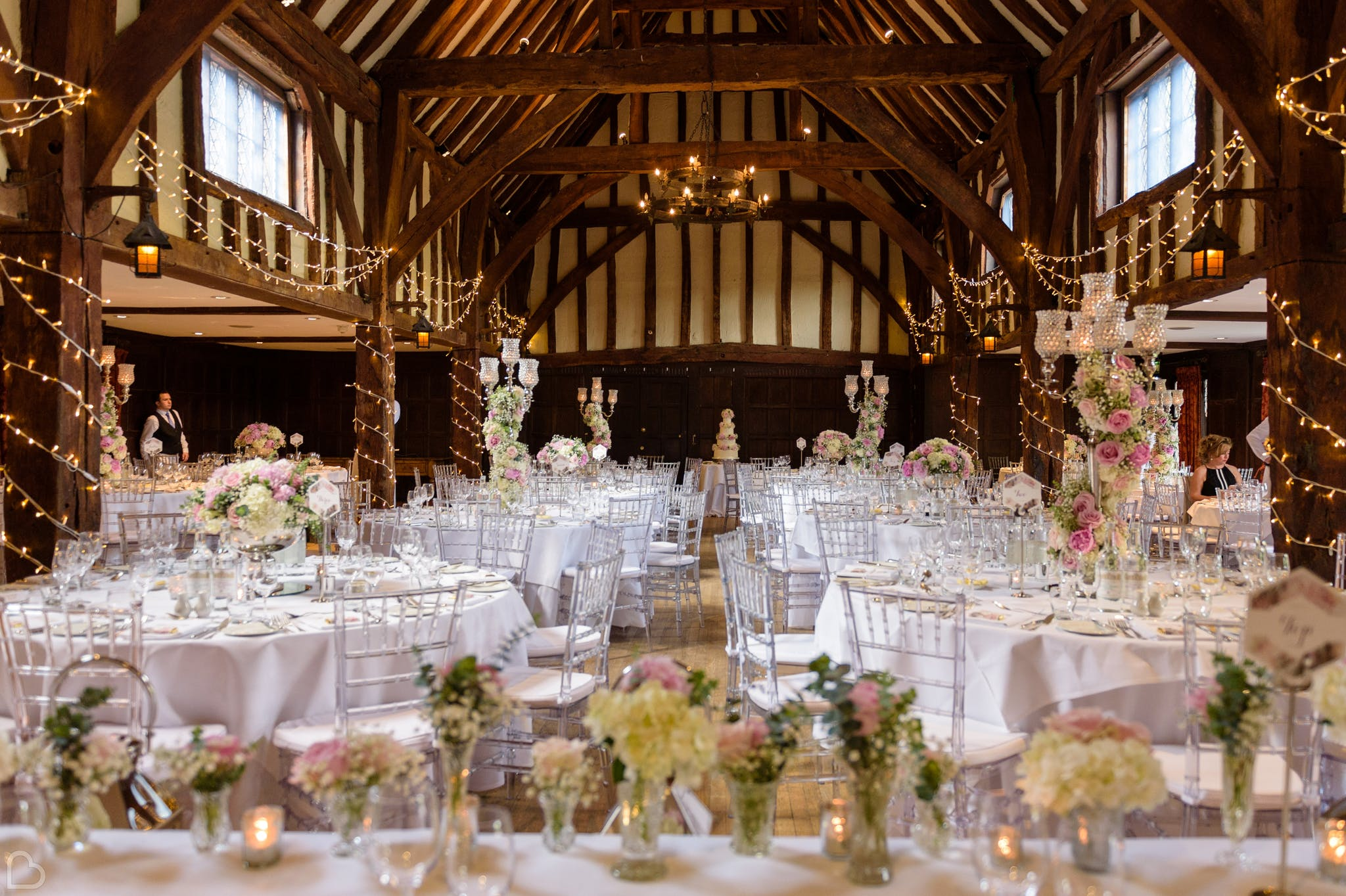 great fosters, a wedding reception venue in London, decorated with fairy lights and pastel flowers for a wedding lunch