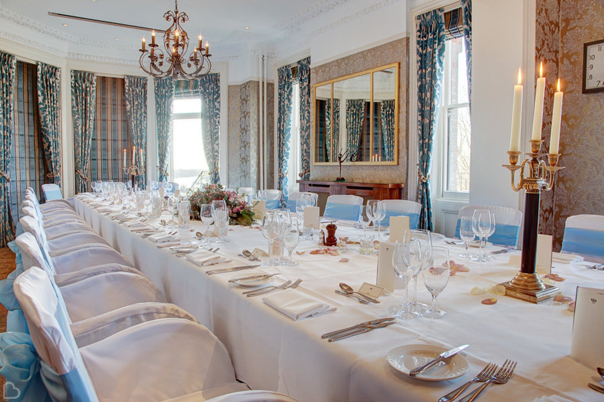 a table is set up for a wedding lunch at the petersham hotel