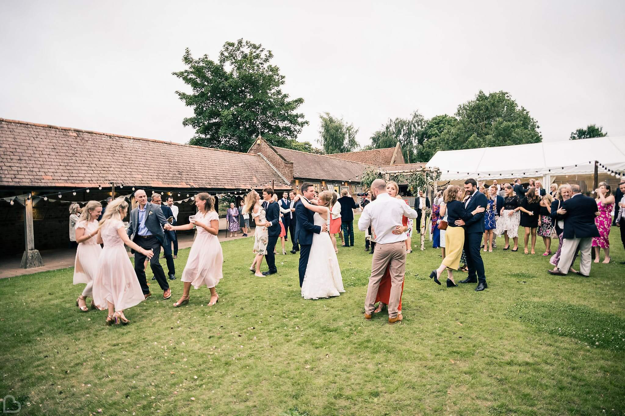 wedding guests dance at the night yard in kent