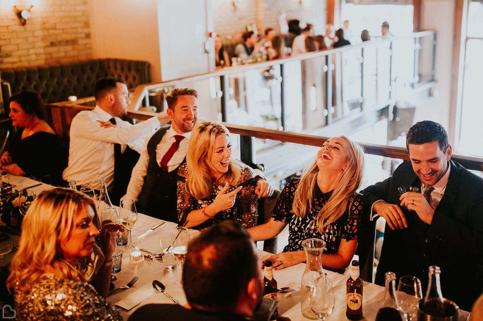 guests laugh and drink at st. bart's brewery in london