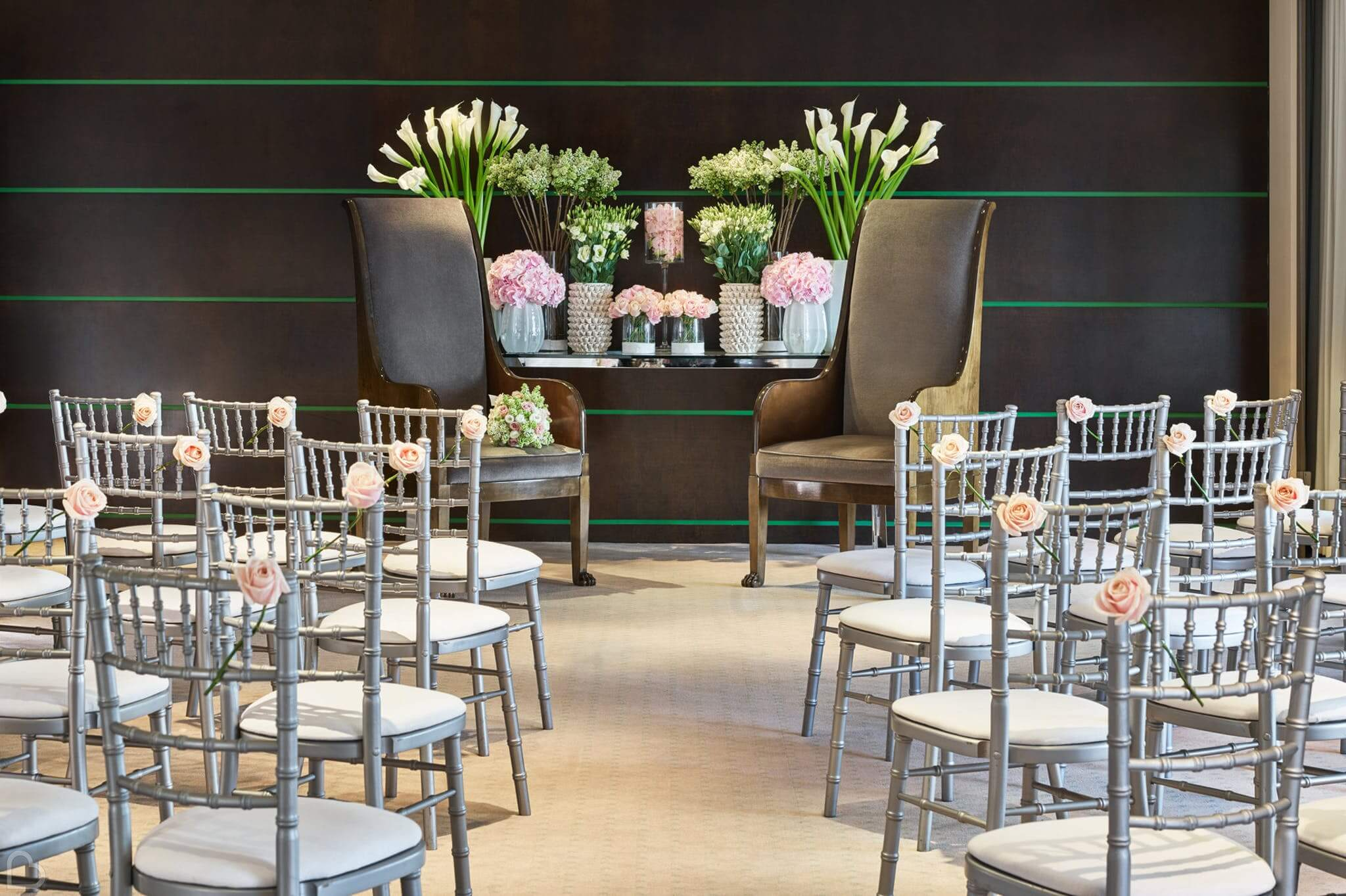 one aldwych hotel with chairs and flowers set for a wedding ceremony