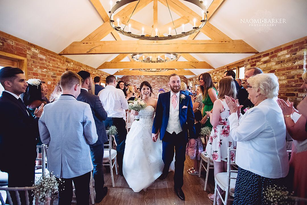 apton hall wedding venue newlyweds exiting the ceremony as guests cheer