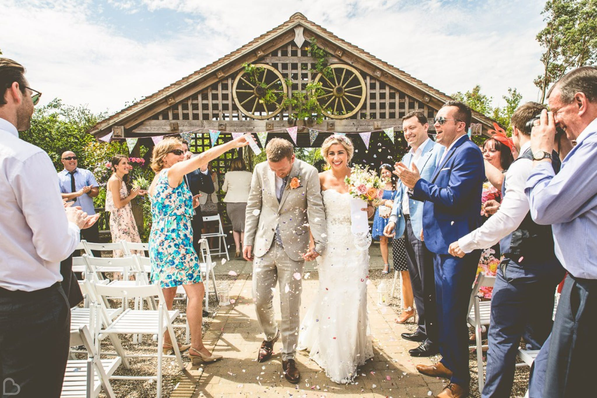 newlyweds and guests confetti shot at Maidens Barns