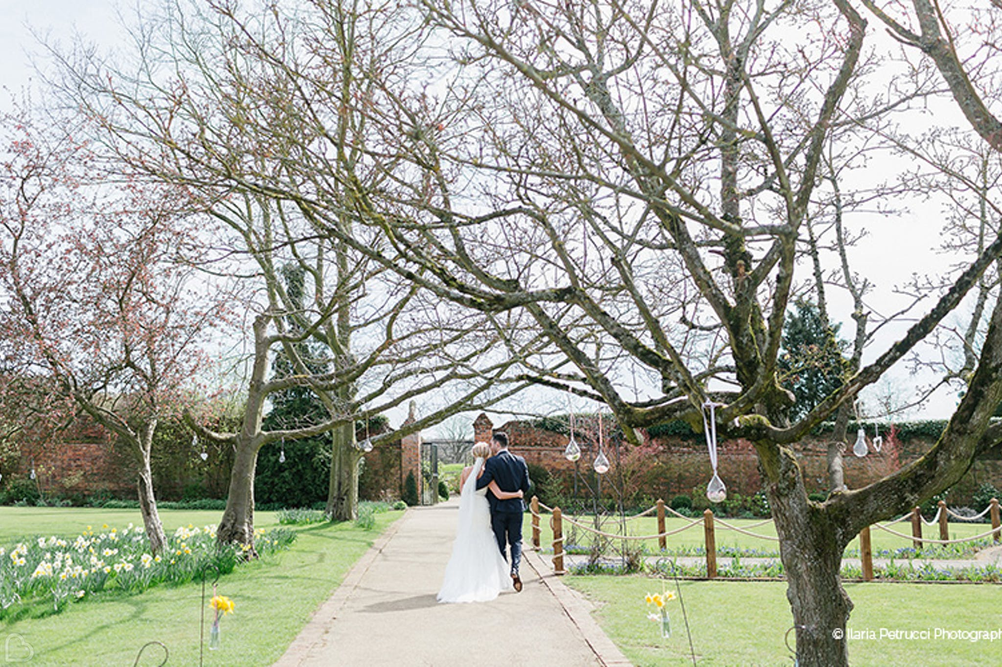 Newlyweds walking through Gaynes Park wedding venue in Essex