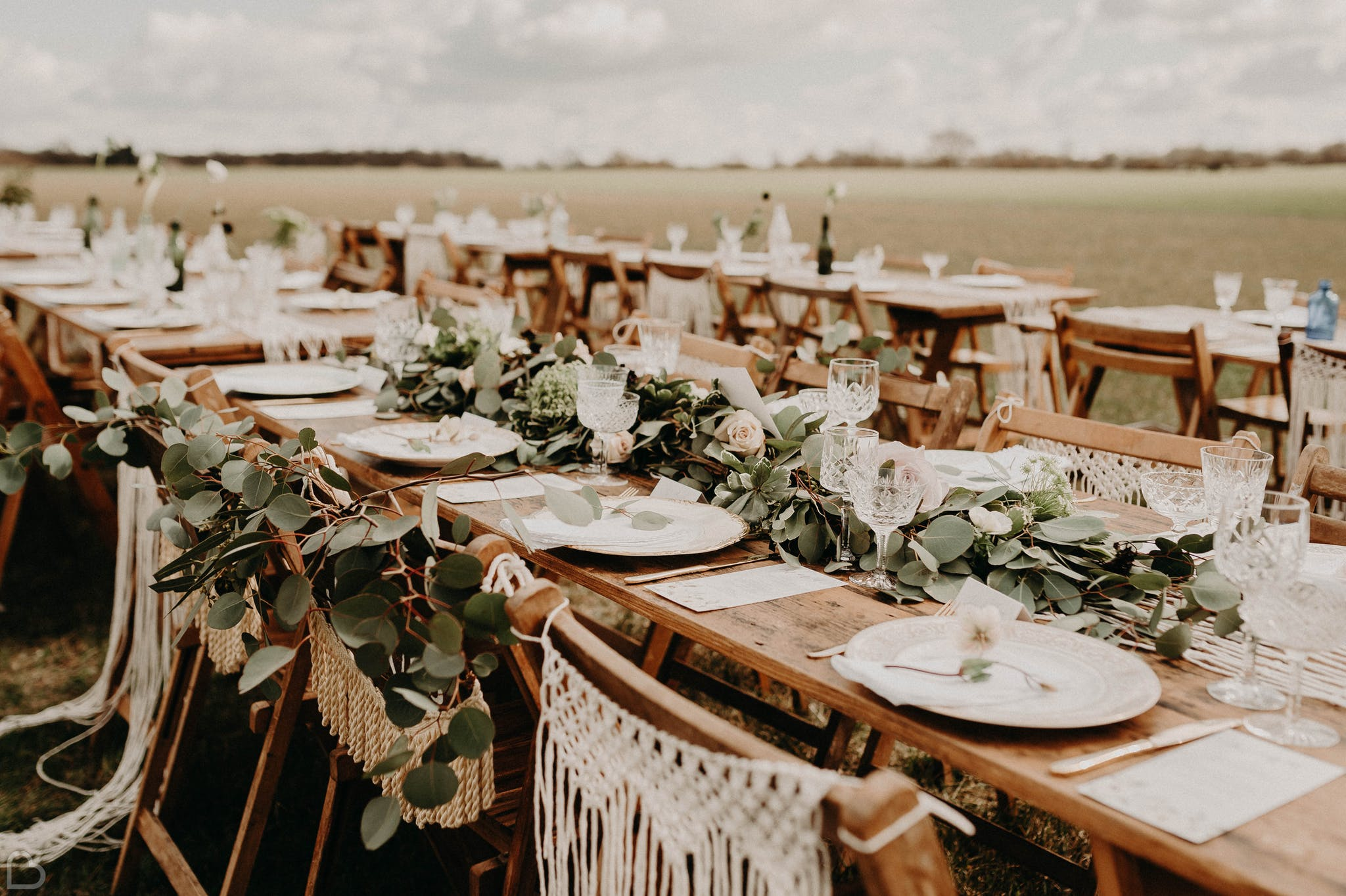 Tables set for a boho wedding at The Barns at Lodge Farm, a wedding venue in essex.