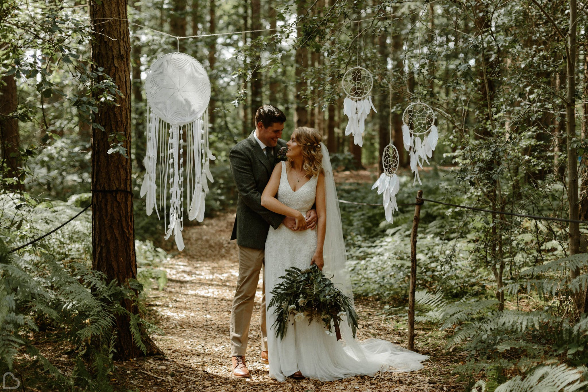 Newlyweds in the forrest at Camp Katur, a woodland wedding venue.