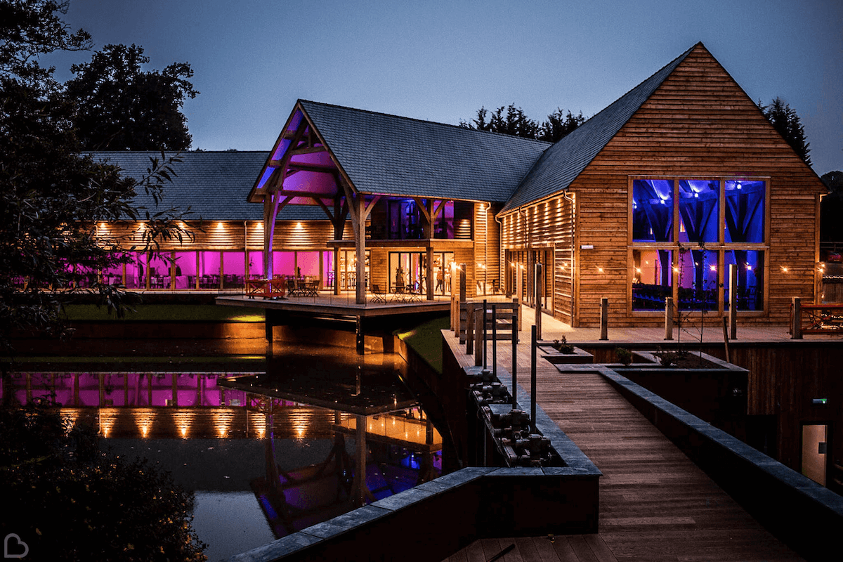 The Mill Barns lit up with purple and blue lights for a night party.