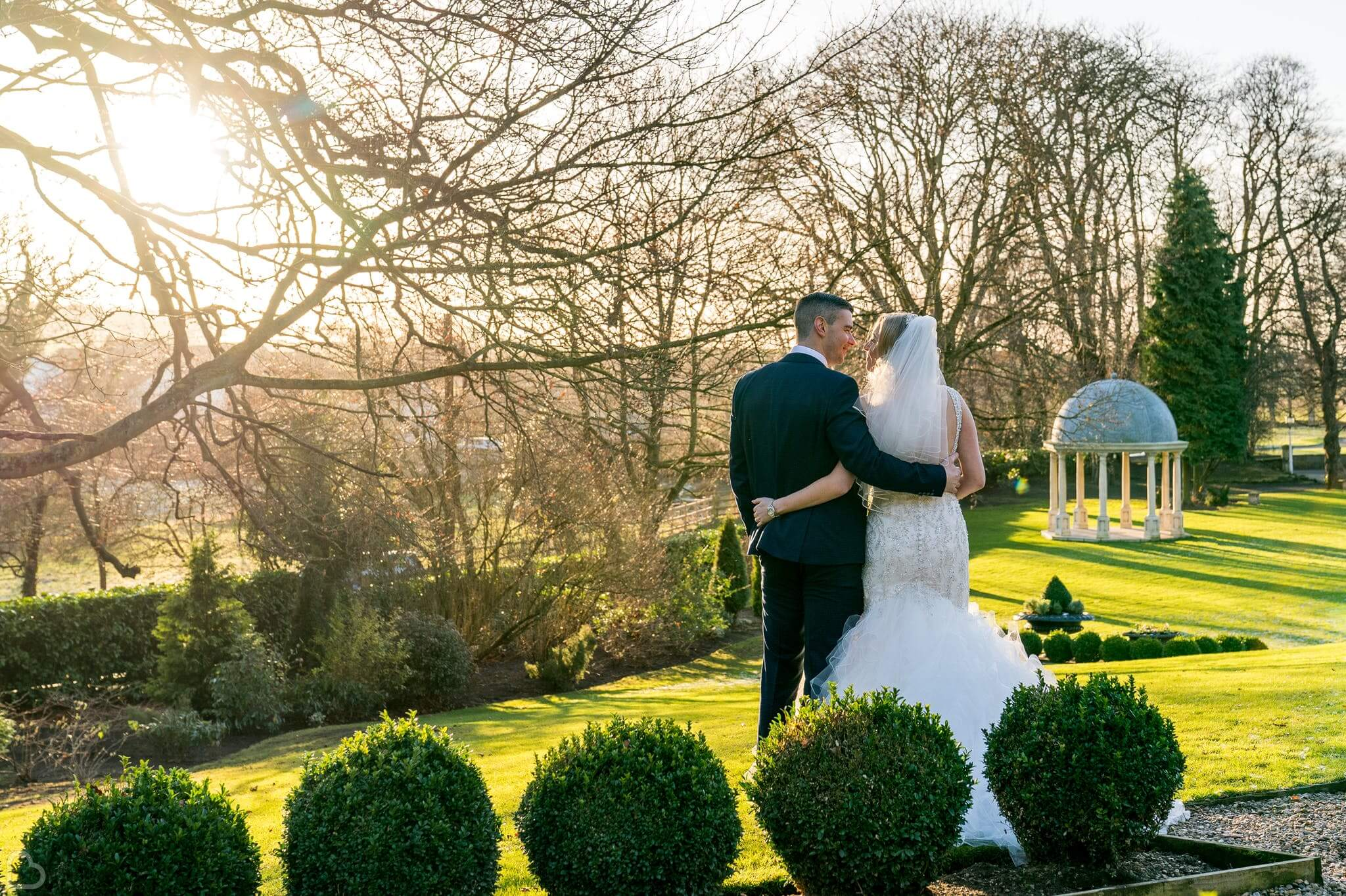 Couple embrace in the gardens of Wentbridge House Hotel