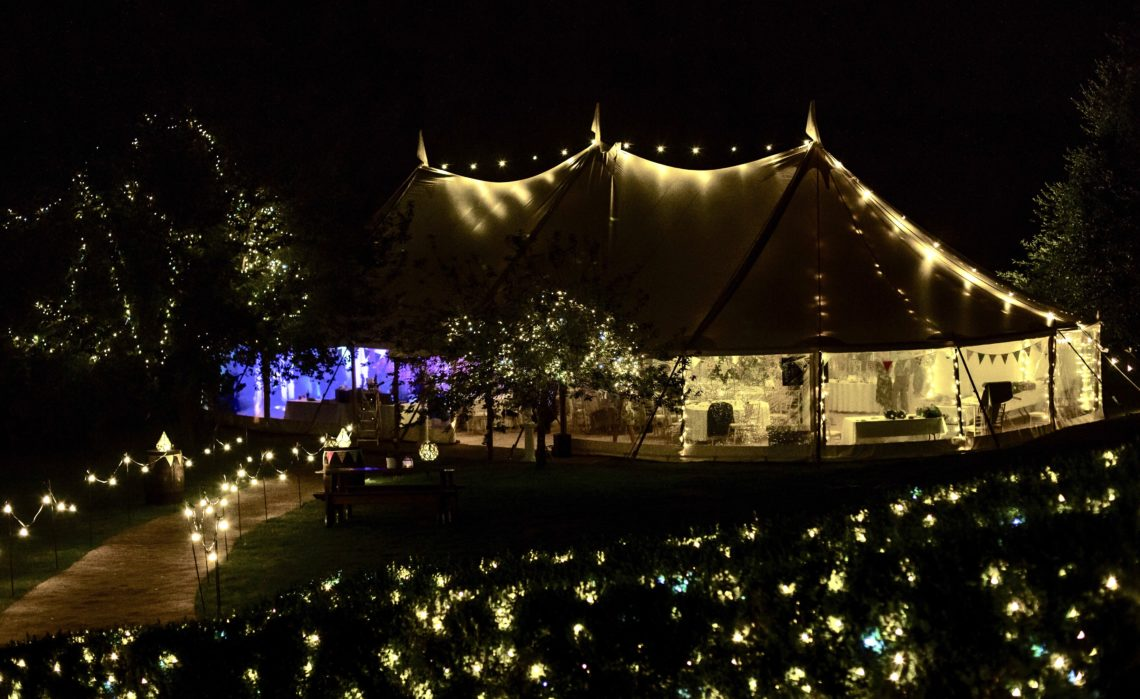 Tipi style marquee lit with fairly lights at Lodge farm House