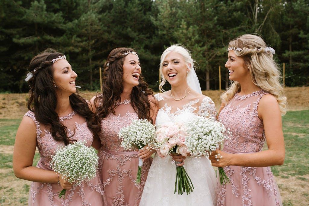Bride and her bridesmaids pose outside The Glade at Rosliston Forestry Centre