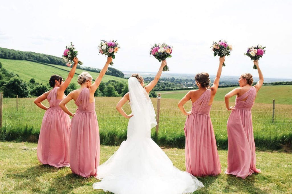Bride and her bridesmaids pose at Little Wold Vineyard,
