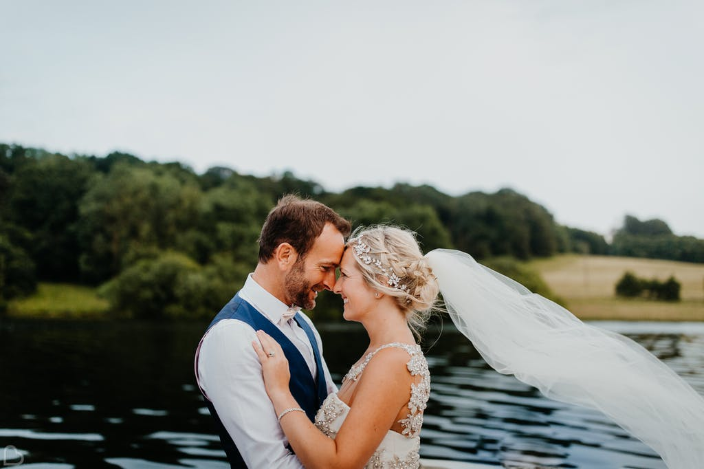 Newlyweds embrace at Bewl Water.