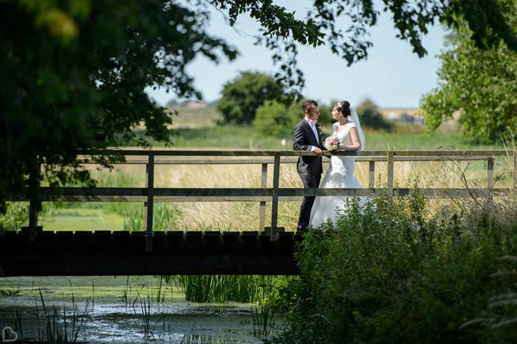 Newlyweds chat on the bride at Stoneless Golf Club, a cheap wedding venue in Kent.