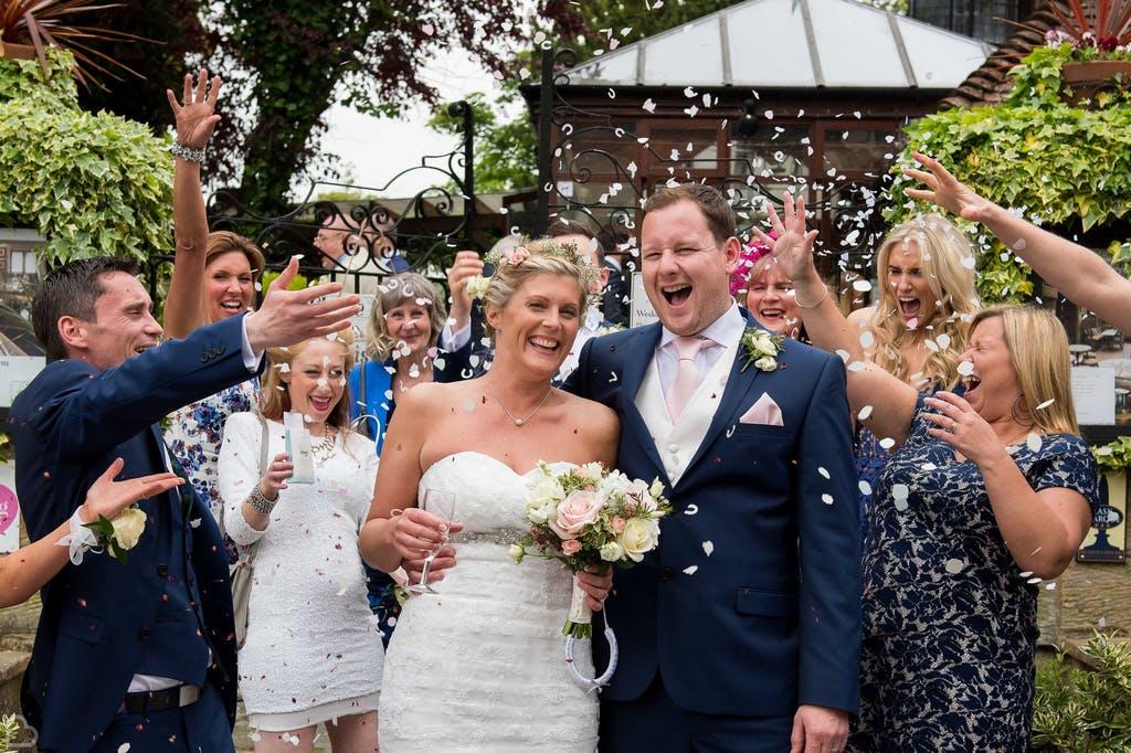 Happy newlyweds' confetti shot at The Barn.