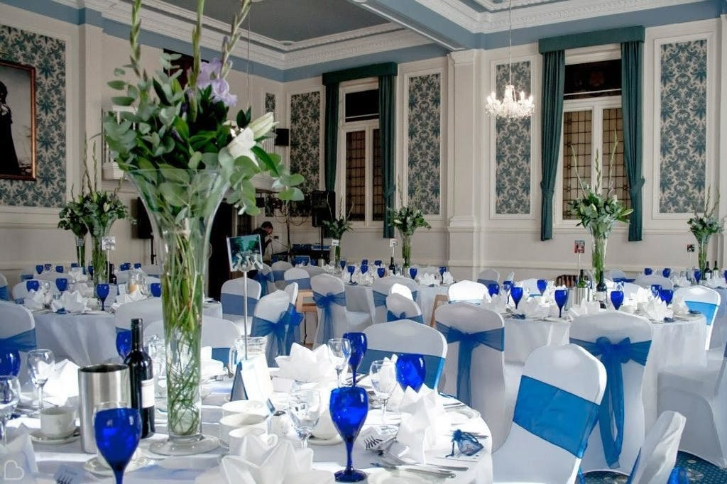 Blue and white themed wedding lunch with large vases for centrepieces.