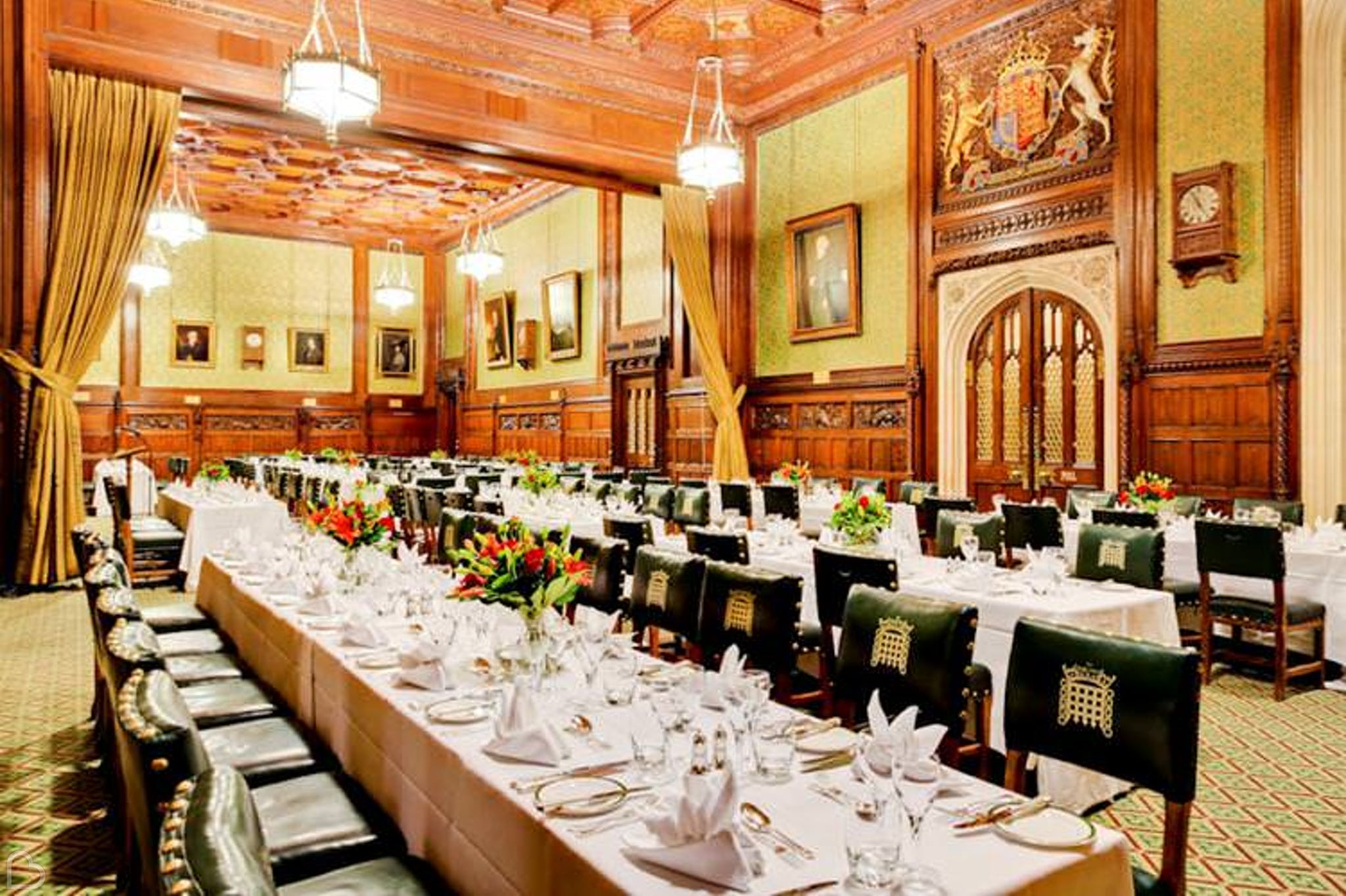 house of commons set up for wedding dinner.