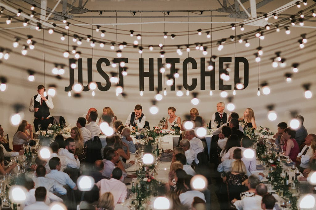wedding dinner beautifully decorated with fairy lights at shoreditch studios