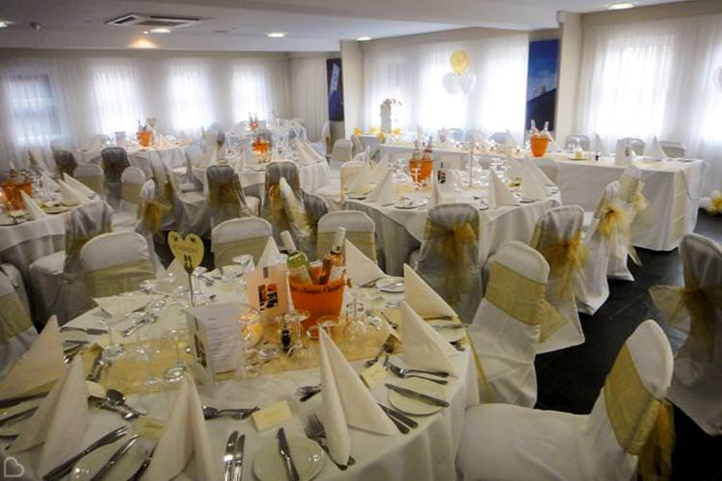 wedding lunch with tones of yellow and orange the selhurst park stadium.