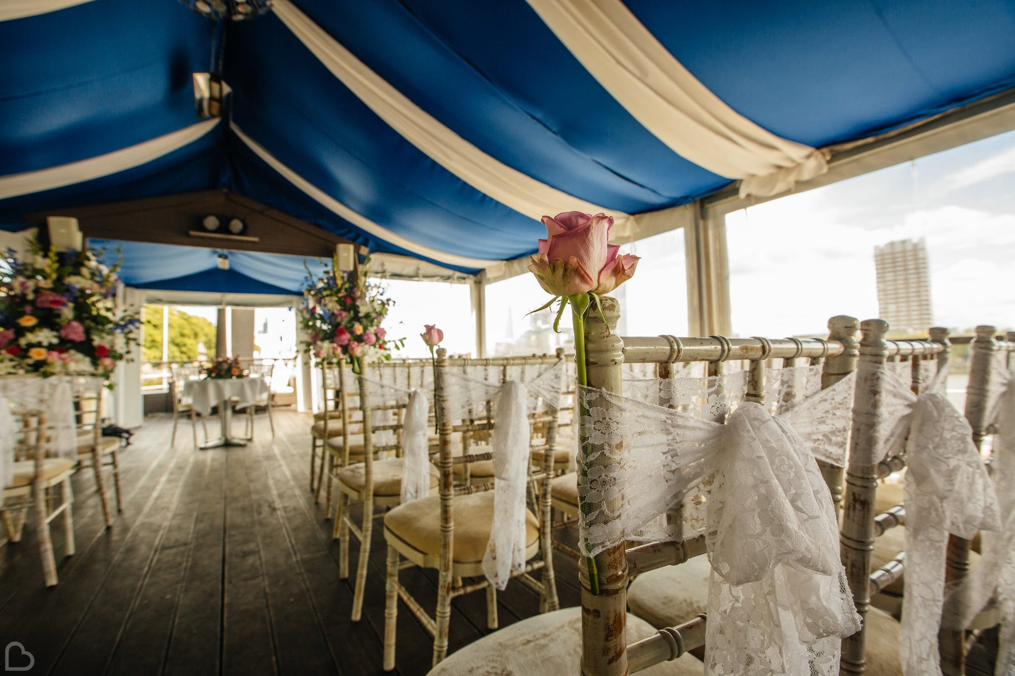 chairs set up for an outdoors ceremony at the yacht in london.