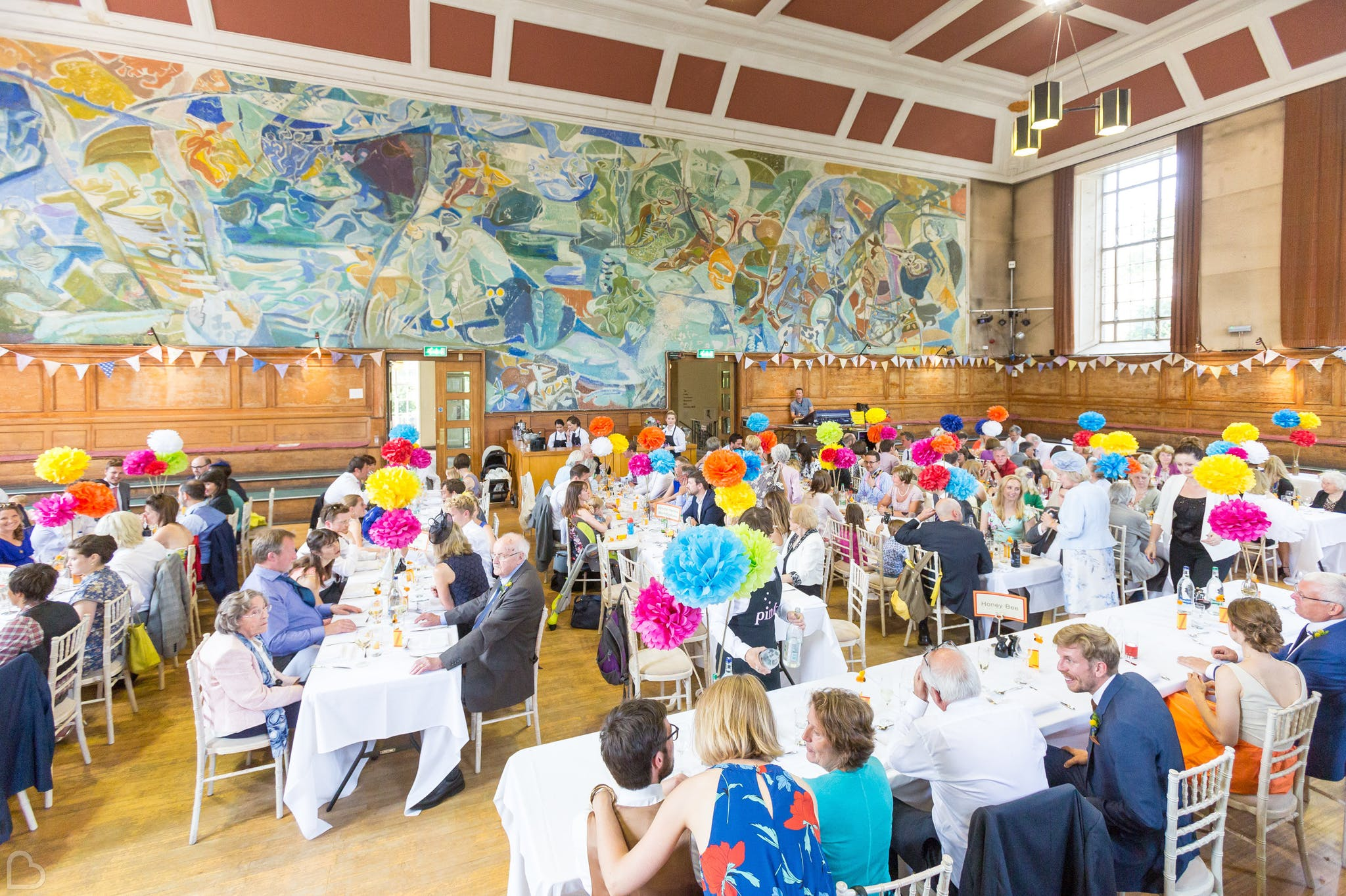 colourfully decorated wedding lunch setting at cecil sharp house.