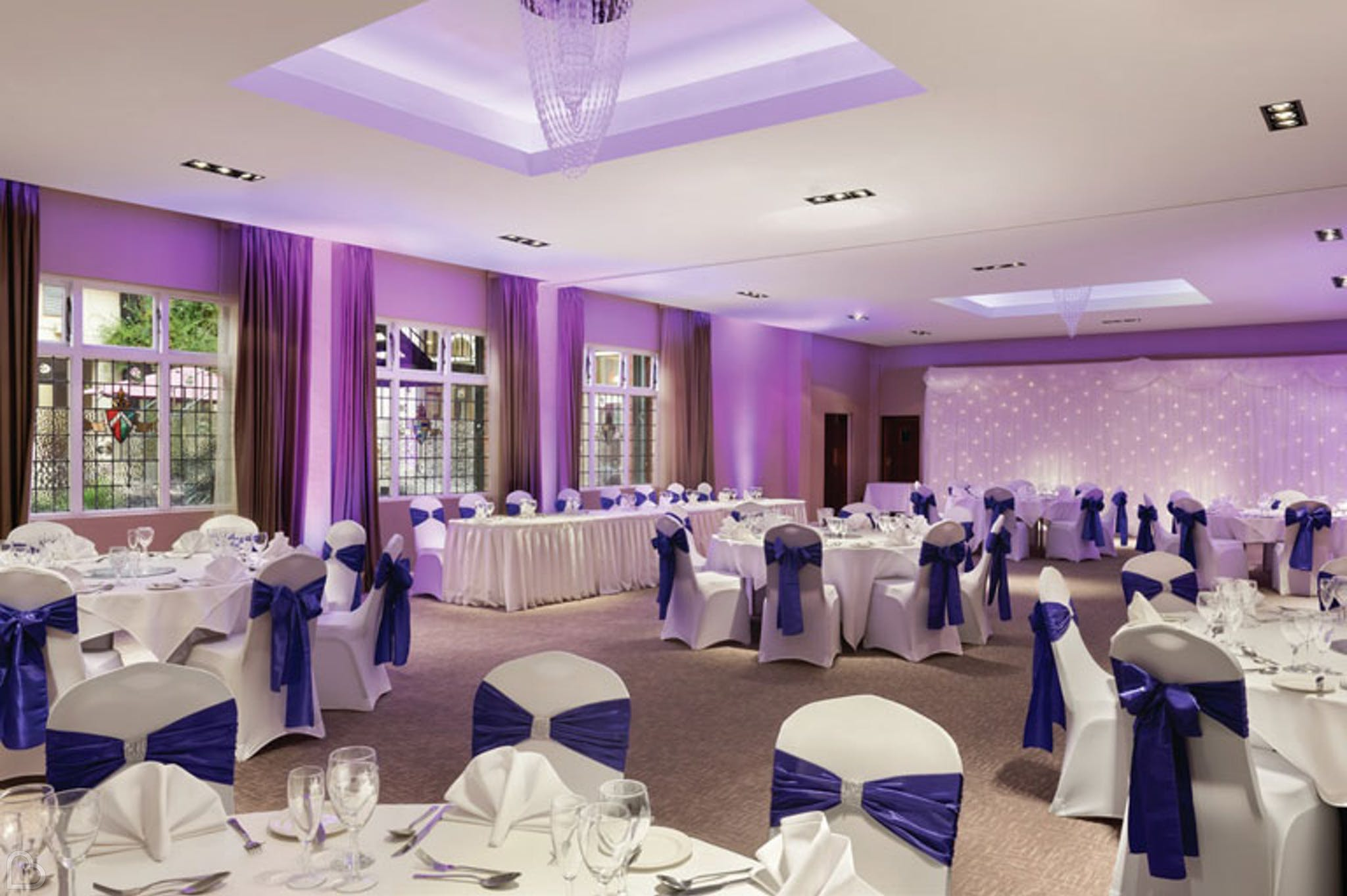 wedding dinner set up in tones of purple at ramada solihull.