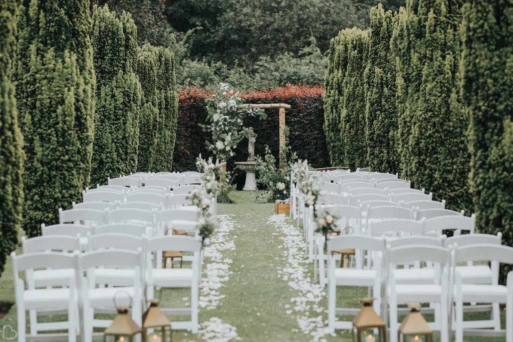 outdoors wedding ceremony amongst the trees in the holford estate.