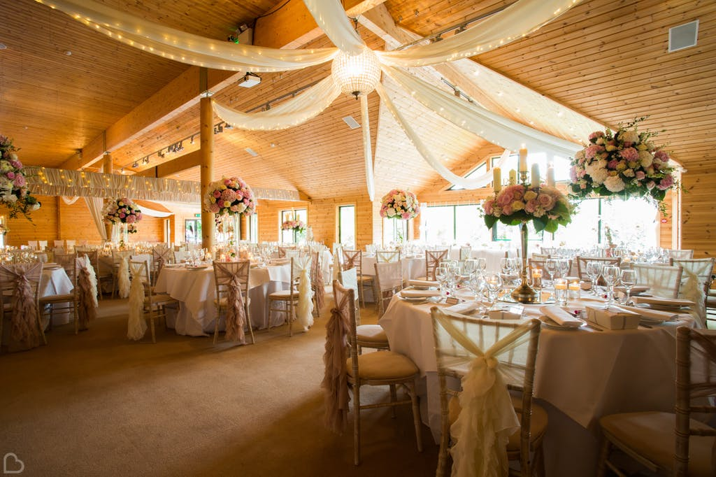 Beautiful large wedding lunch decorated with long sheets  and styal lodge.