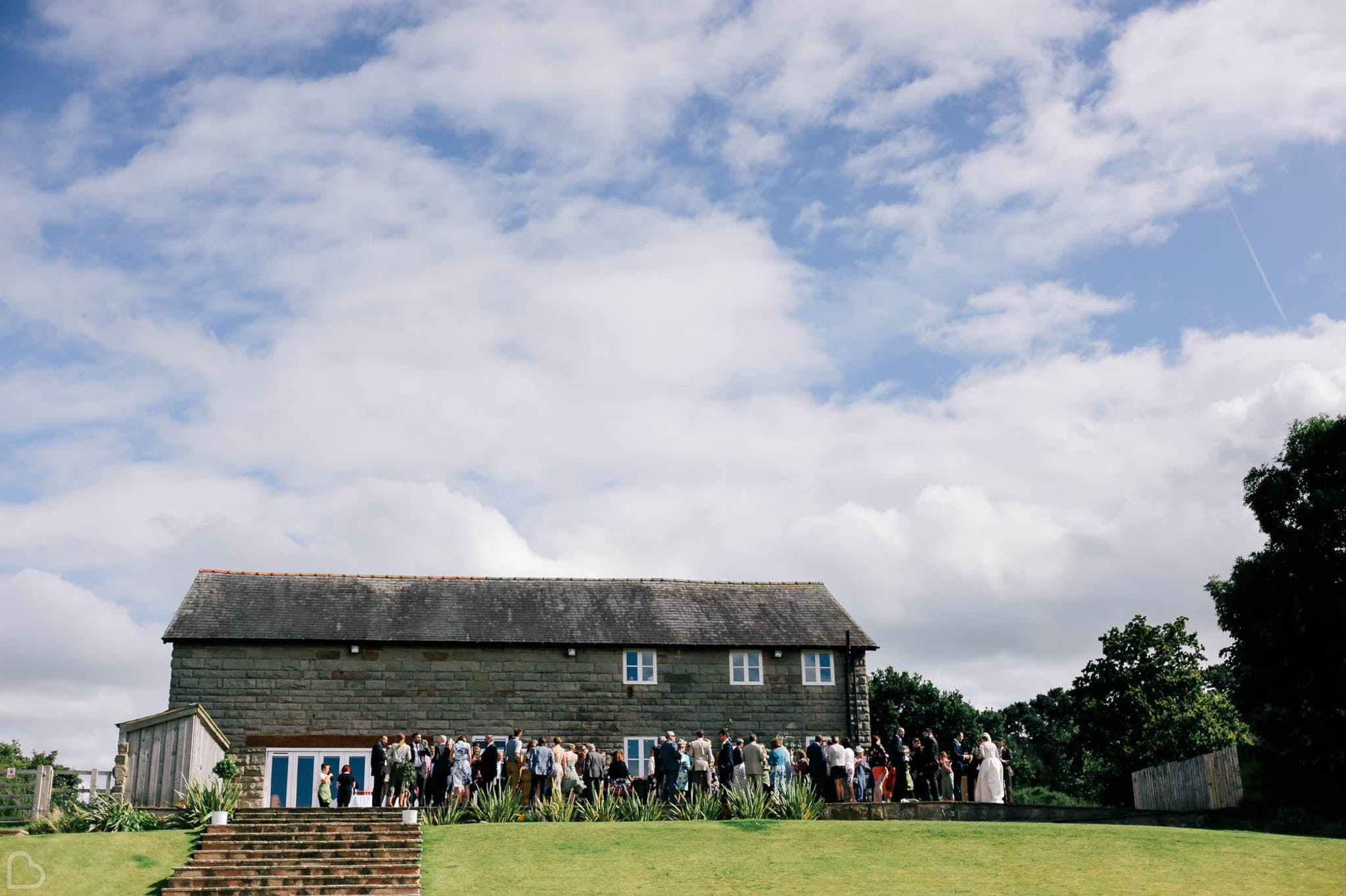 guests gather outside curdlands barn