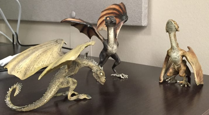Resin figurines of Daenerys' dragons on my desk.