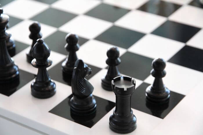 A chessboard with its pieces ready to begin a game