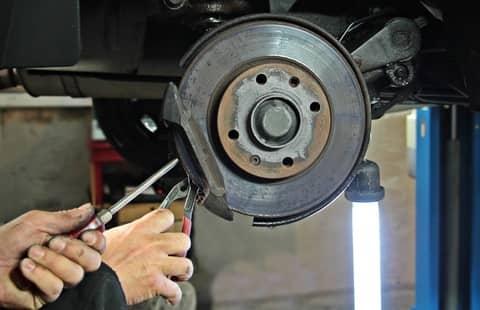 mechanic doing break repair
