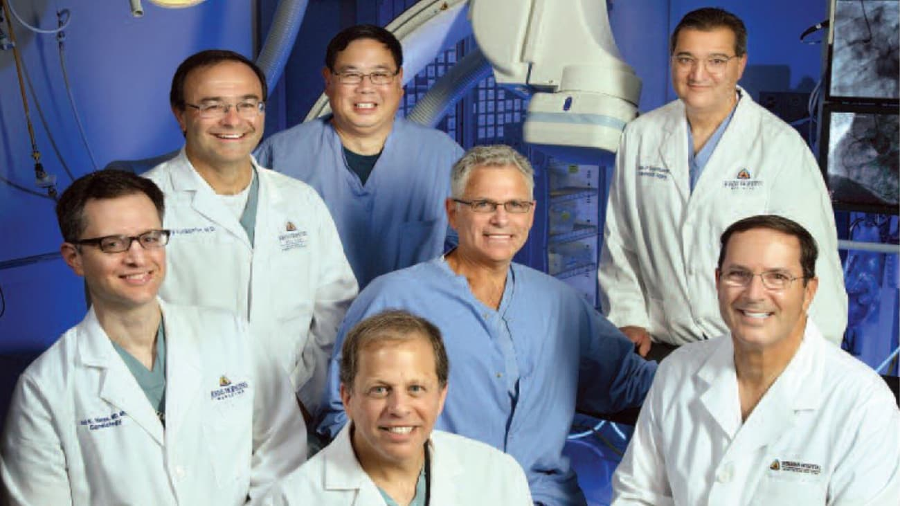 From left, front row: Drs. Rani Hasan, interventional