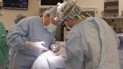 Two-incision approach to sleep surgery implant