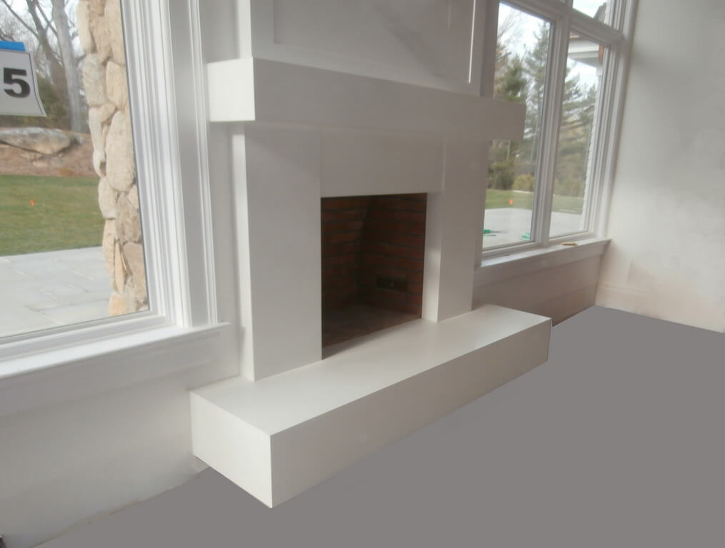 Modern White Concrete Fireplace Surround And Mantel