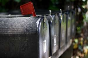 Row of old mailboxes in apparently rural setting