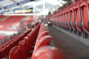 Rows of empty seats in a sports stadium
