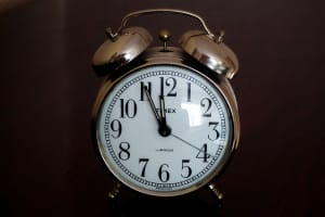 Old alarm clock nearing midnight on New Year's Eve