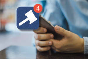 Email concept: Preside app icon atop image of hands holding a smartphone