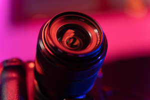Close-up photo of camera lens with colorful mood lighting