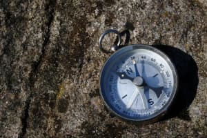 Compass lying on a granite background