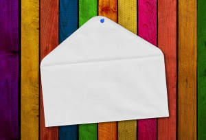 Communications concept: Envelope hanging over color strips