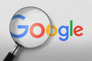 A magnifying glass over the Google logo