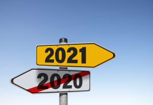Concept - Road signs depicting cancellation of 2020 and path to 2021