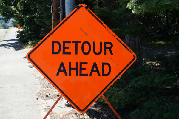 "Orange road sign, ""DETOUR AHEAD"""