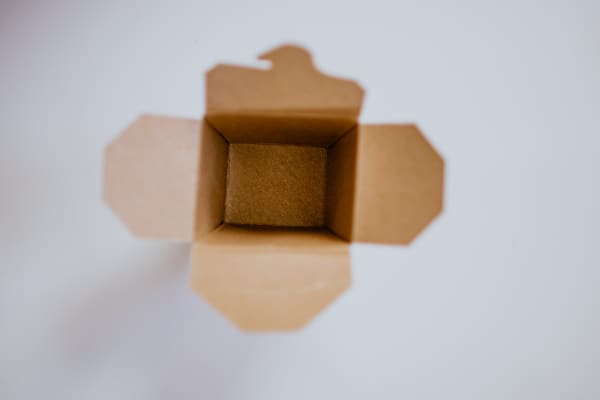 View downward into brown cardboard box with all flaps open