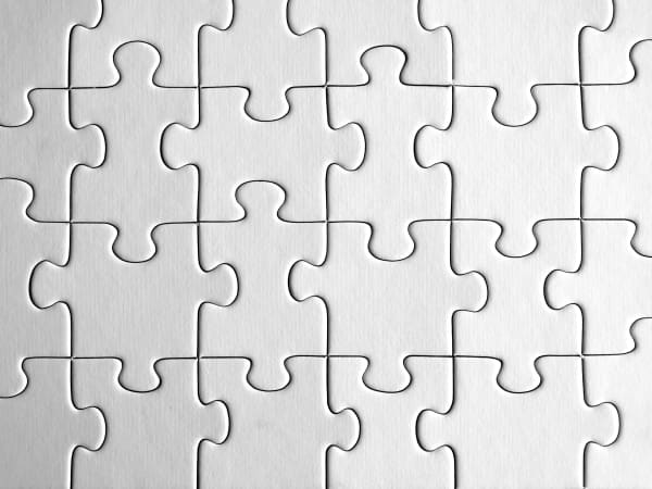 Interlocked pieces of a completed jigsaw puzzle