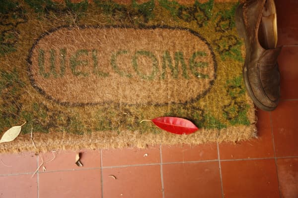 A welcome mat in front of a home
